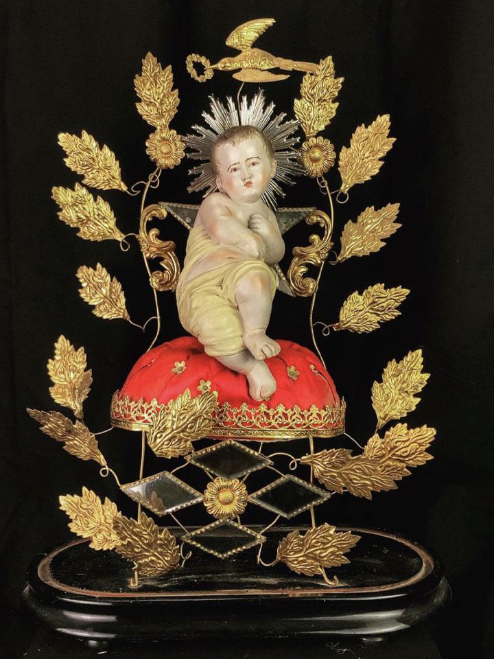 Statua bambino Gesù con foglie oro